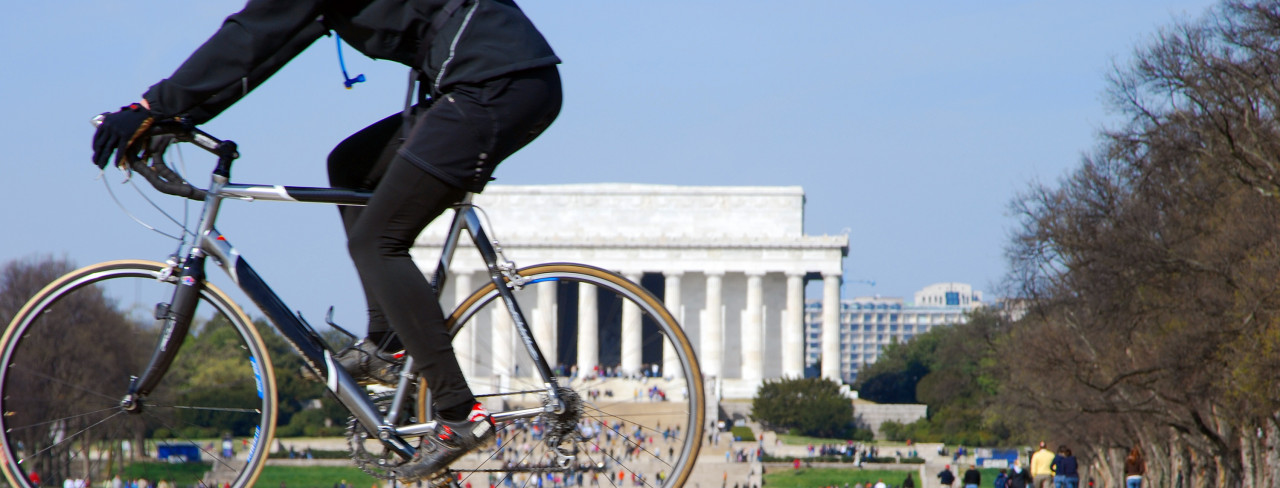 Biker and Lincoln Memorial in reflection